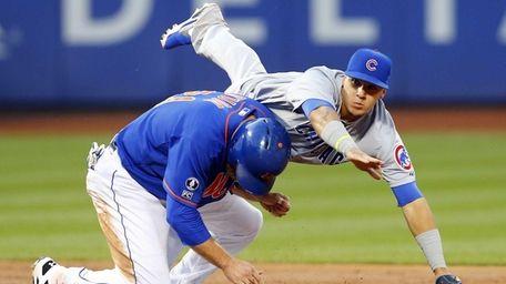 Javier Baez of the Chicago Cubs flips over