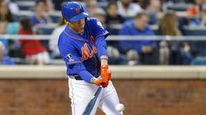 Wilmer Flores of the Mets connects on a
