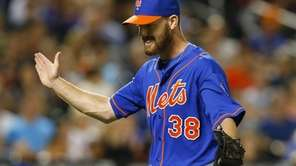 Vic Black of the Mets reacts after the