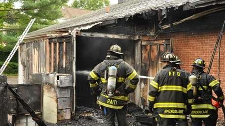Firefighters respond to a fire that consumed part
