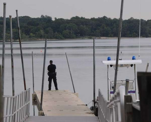 A Suffolk County police officer checks Lake Ronkonkoma
