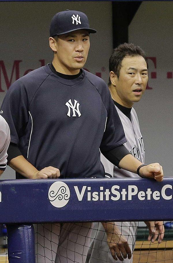 The Yankees' Masahiro Tanaka, left, and Hiroki Kuroda,