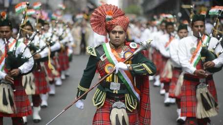 The Swamibapa Pipe Band from New Jersey marches
