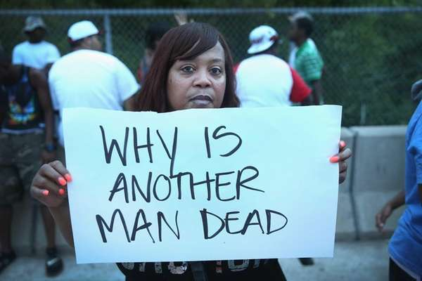 Kelly Berry protests along Florissant Avenue on August