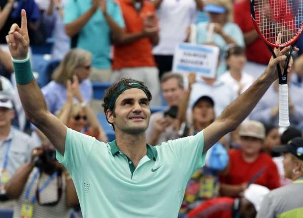 Roger Federer, from Switzerland, celebrates after defeating David