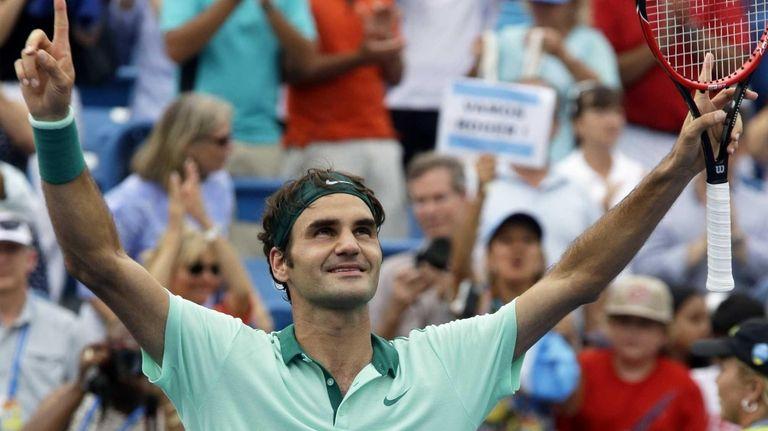 Roger Federer, from Switzerland, celebrates after defeating David
