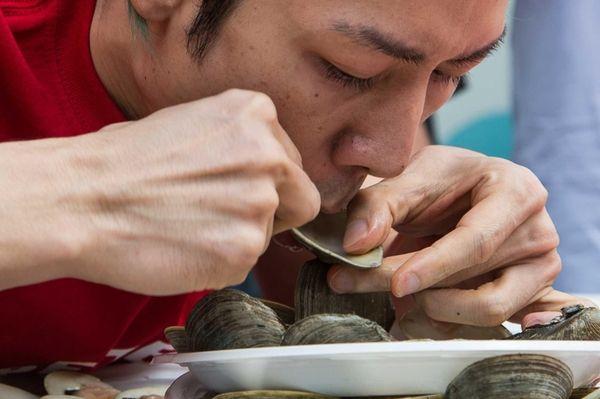 Competitive eater Takeru Kobayashi ate 8 dozen clams