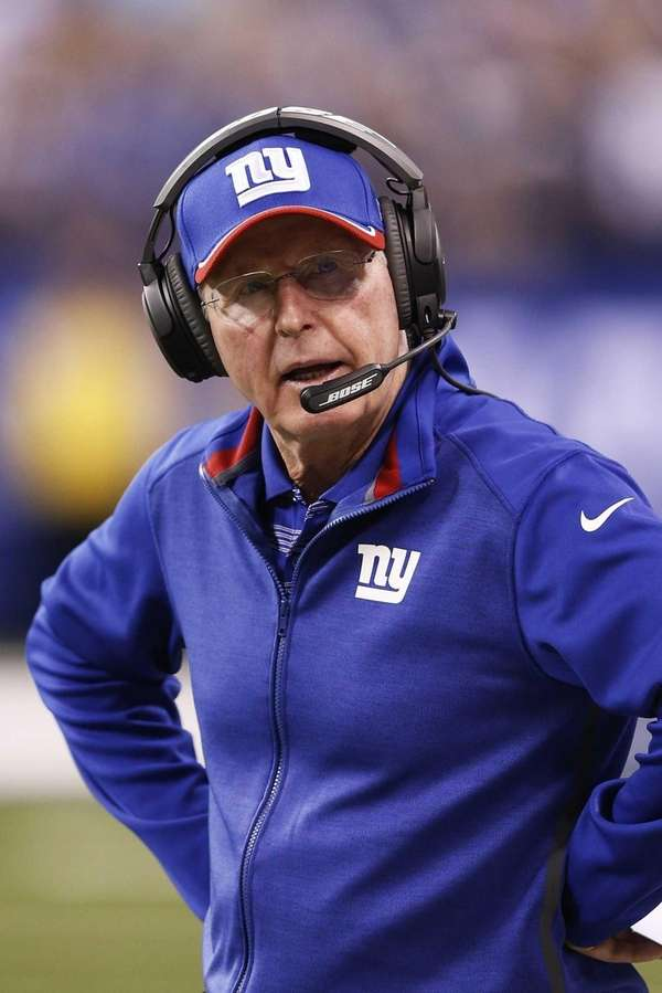 Giants head coach Tom Coughlin looks on in