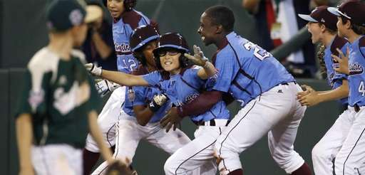 Pearland's second baseman Bryce Laird, left, watches as