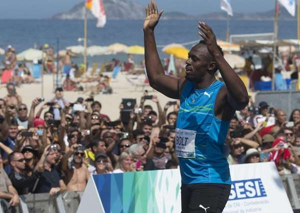 Jamaican Olympic gold medallist Usain Bolt celebrates after