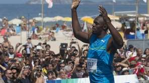 Jamaican Olympic gold medallist Usain Bolt celebrates after