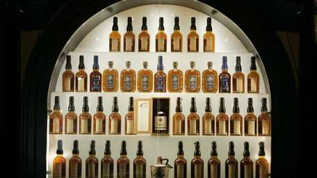 Bottles of bourbon are on display in a
