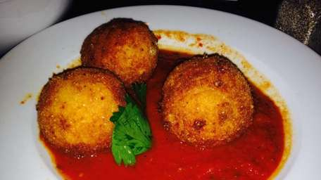Rice balls filled with beef ragu and peas