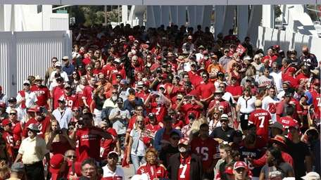 Fans walk outside of Levi's Stadium before an