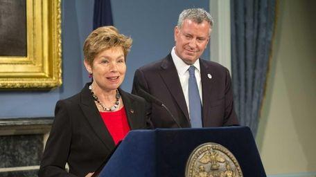 Loree Sutton, center, thanks Mayor Bill de Blasio