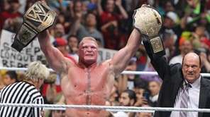 Brock Lesnar celebrates with Paul Heyman after winning