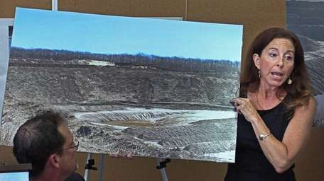 Adrienne Esposito holds a photo of a Sand