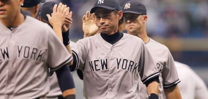 The Yankees' Ichiro Suzuki celebrates with teammates after
