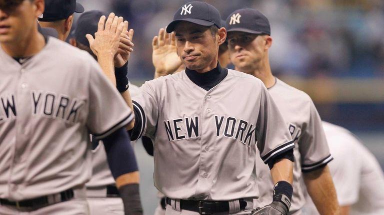 The Yankees' Ichiro Suzuki celebrates with teammates after