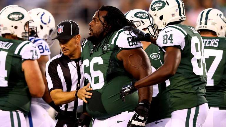 Jets guard Willie Colon reacts after losing his