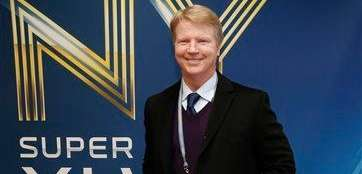 Phil Simms arrives at Super Bowl XLVIII on
