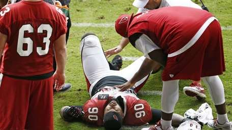 Arizona Cardinals defensive end Darnell Dockett is atended