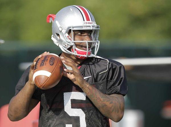 Ohio State quarterback Braxton Miller warms up during