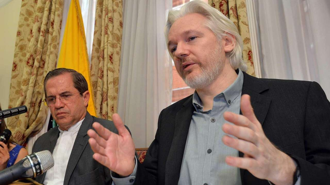 WikiLeaks founder Julian Assange sits next to Ecuadorian
