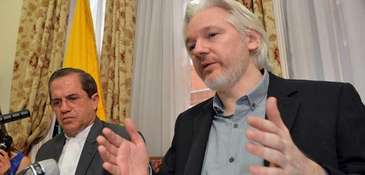 WikiLeaks founder Julian Assange, right, with Ecuadorian Foreign