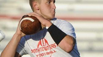 Smithtown East quarterback John Danigellis throws during football