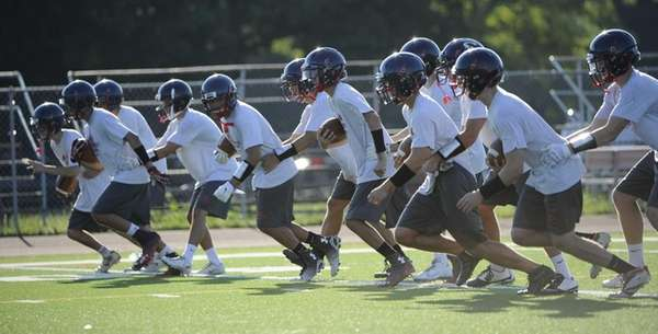 Smithtown East players run drills during football practice