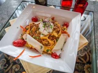 A stellar dish of Pappardelle Bolognese is enriched