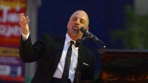 Billy Joel performs in Times Square for a
