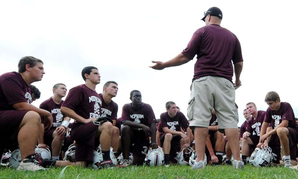 Mepham head coach Anthony Cracco talks to his