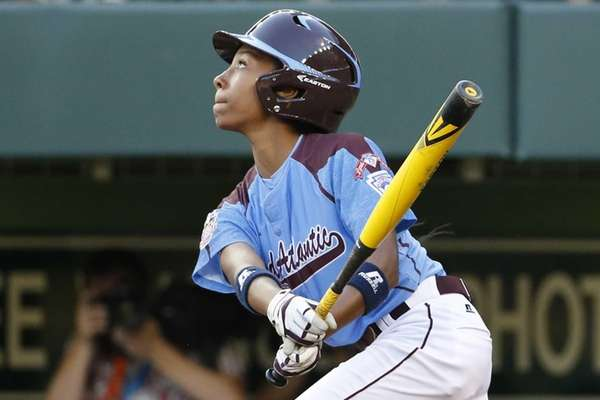 Philadelphia's Mo'ne Davis drives in a run with