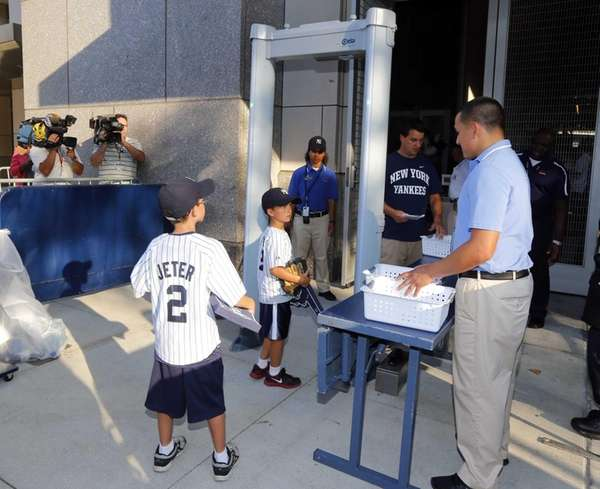 Fans enter Yankee Stadium through a metal detector