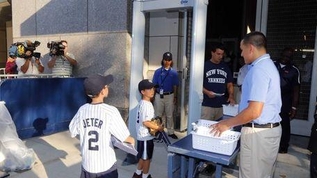 Fans enter Yankee Stadium through a metal detector