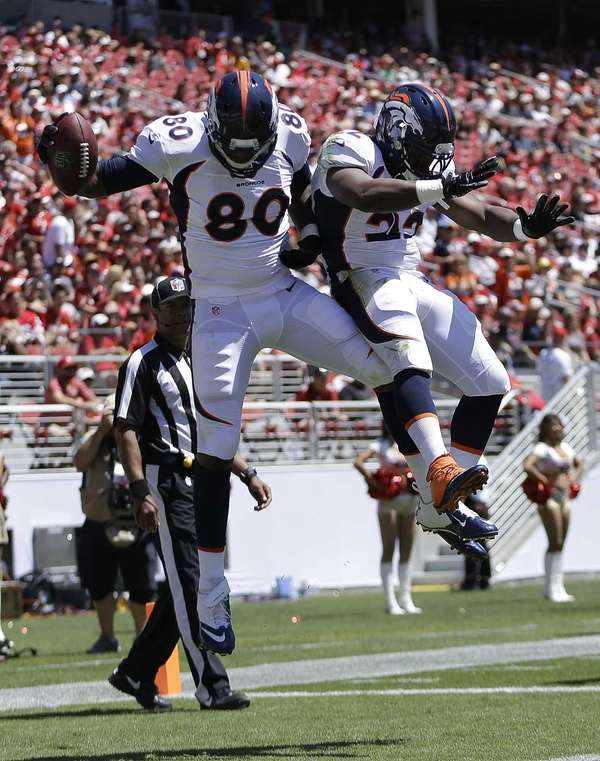 Denver Broncos tight end Julius Thomas (80) celebrates
