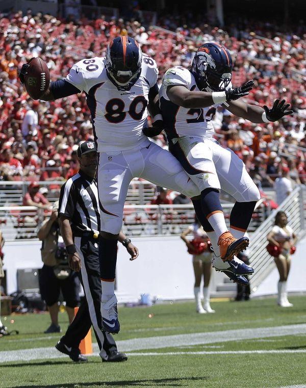 Denver Broncos tight end Julius Thomas (80) celebrates