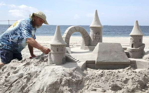 Sea Cliff resident and professional sand sculptor Andy