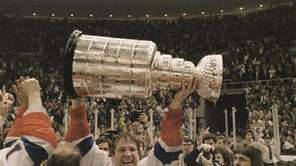 Islanders captain Denis Potvin holds the Stanley Cup