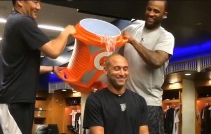 Derek Jeter has water dumped on his head