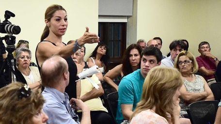 Commack resident Elif Binger speaks during a public