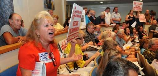 Barbara Donovan, left, an Elwood resident in opposition