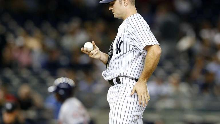 David Robertson of the Yankees looks at a