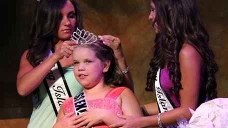 Kaitlyn Keisner, 9, of Coram, is crowned Miss