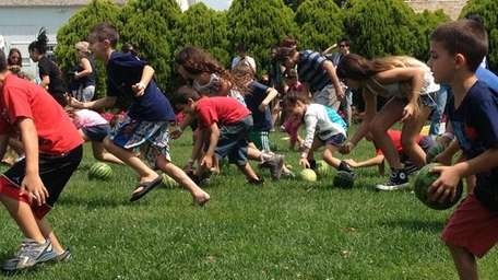 Visitors participate in the watermelon rolling contest at