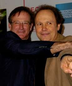 Robin Williams, left, and Billy Crystal arrive for