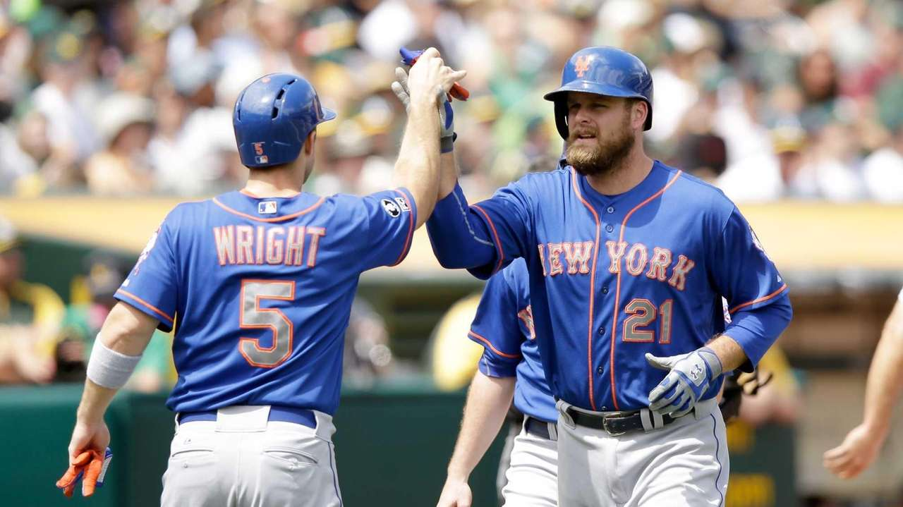 Lucas Duda of the Mets is congratulated by