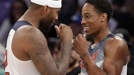United States center DeMarcus Cousins, left, shares a